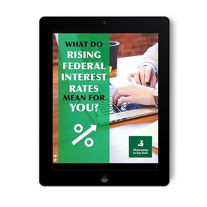 """ipad with cover of PDF reading """"What do Rising Federal Interest Rates Mean for You?"""" in a vertical green bar over an image of a person working on a laptop"""